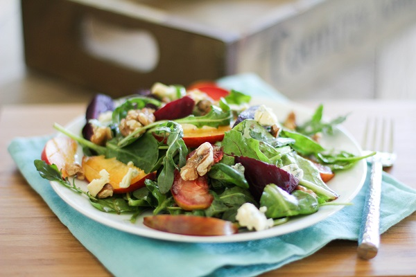 Roasted Beet Salad with peaches, pluots and blue cheese | https://www.theroastedroot.com