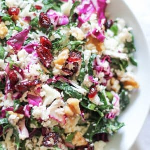 Raw Cauliflower Couscous - packed with cabbage, kale, walnuts, dried cranberries with a zesty dressing. Vegan, paleo, gluten-free, healthy!