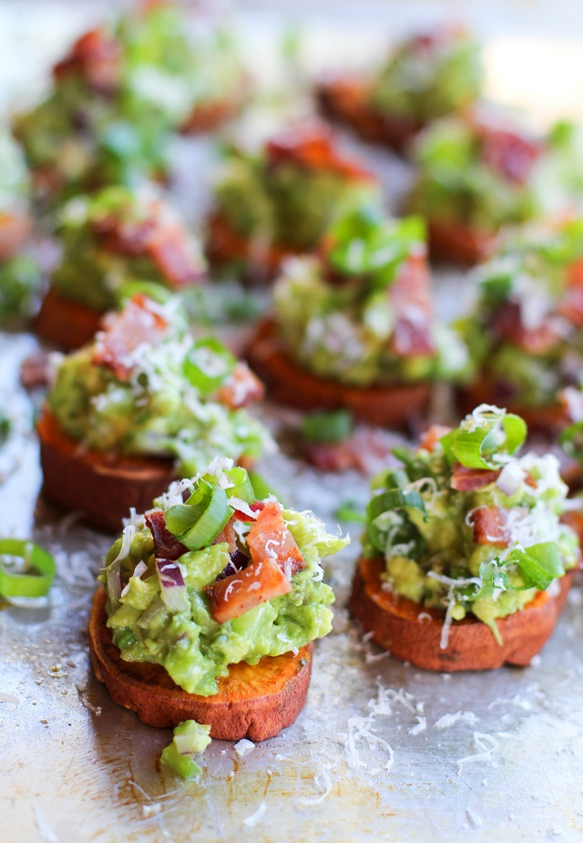 Roasted Sweet Potato Rounds with Guacamole and Bacon   theroastedroot.net #paleo #vegan #recipe #appetizer